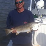 A satisfied customer with his Port Aransas catch of the day!